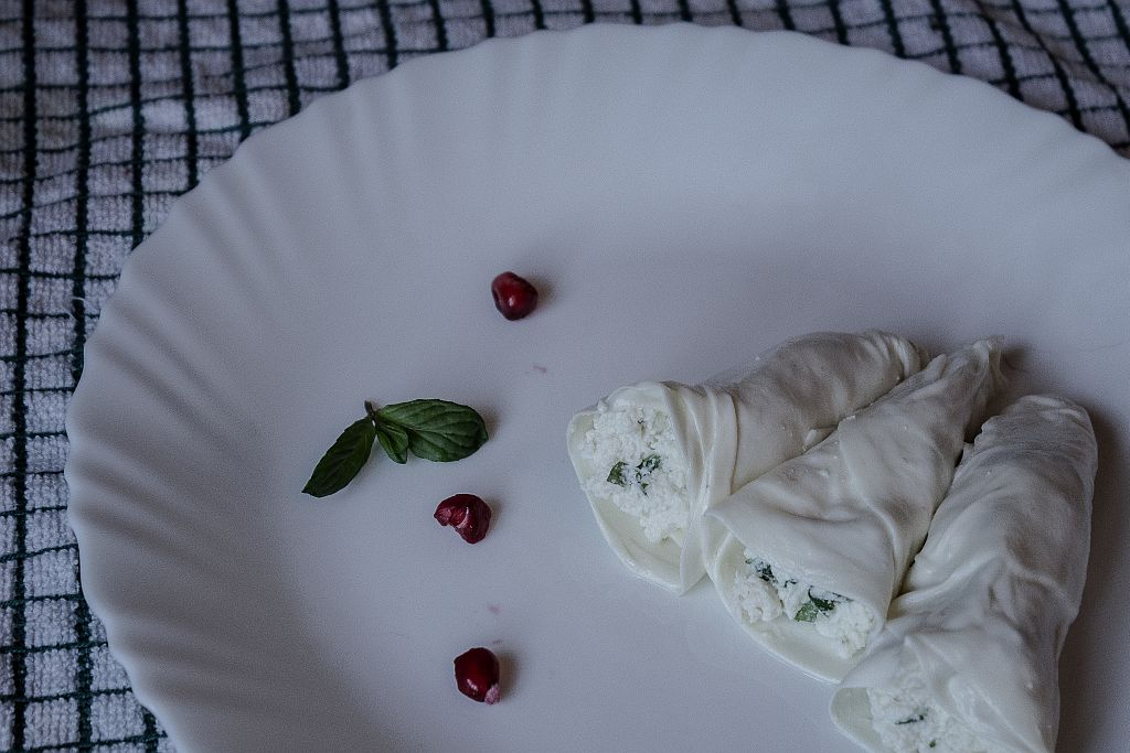 Wrap that fresh cheese blended with mint into those sulguni cheese plates