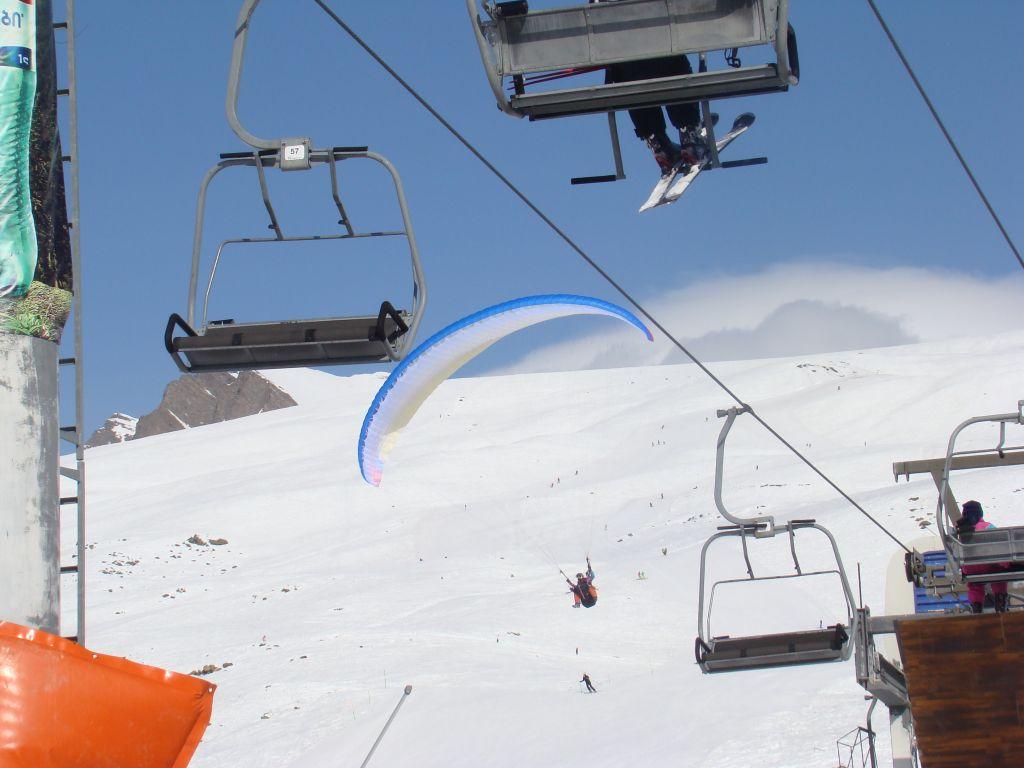 Paragliding - a close landing to ski lifts