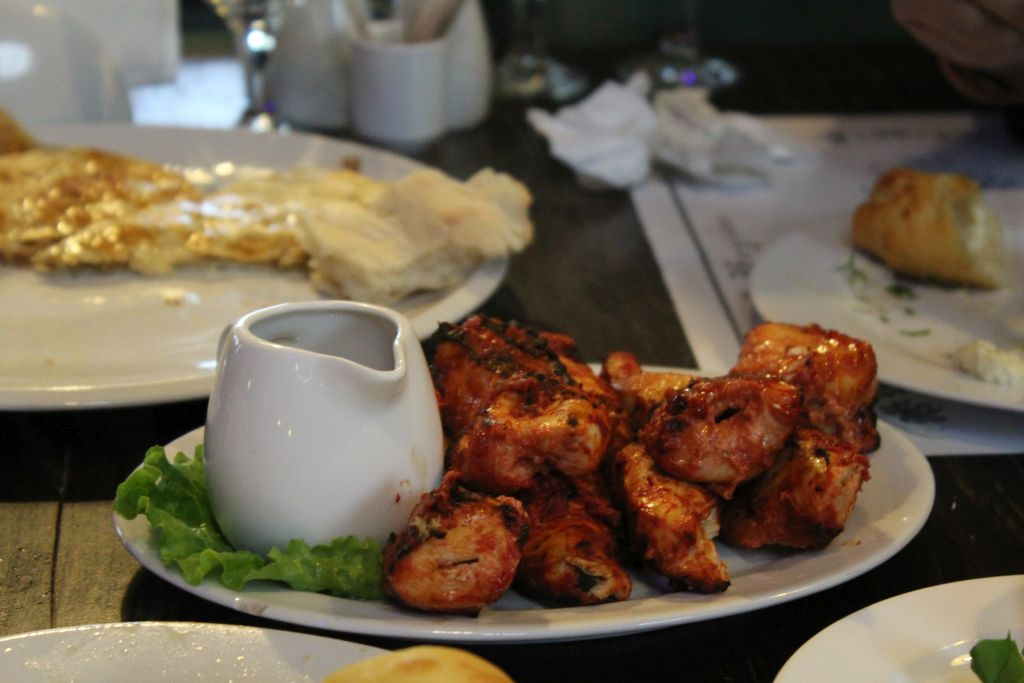 Chicken barbecue accompanied with pomegranate sauce