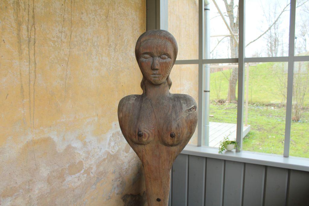 Wood carved naked lady at Bangert's restaurant