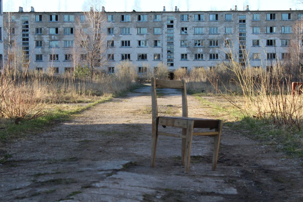 A chair and abandoned block house at Skrunda Ghost Town