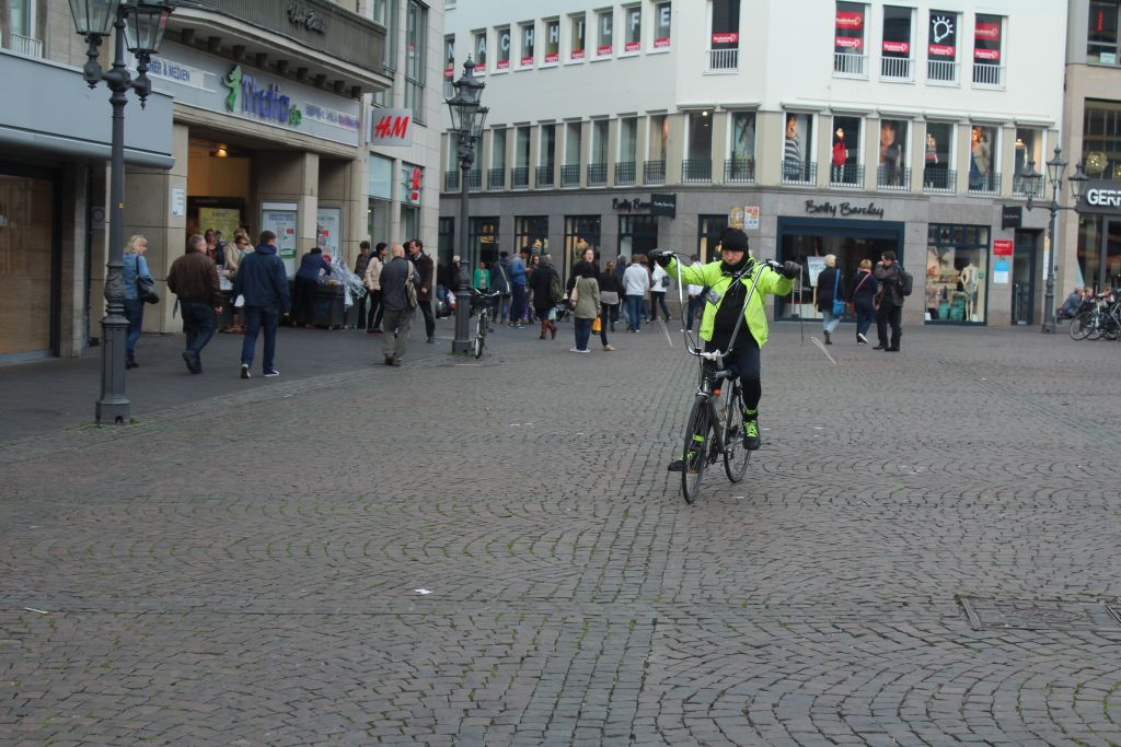 A cyclist in Bonn's marketplace