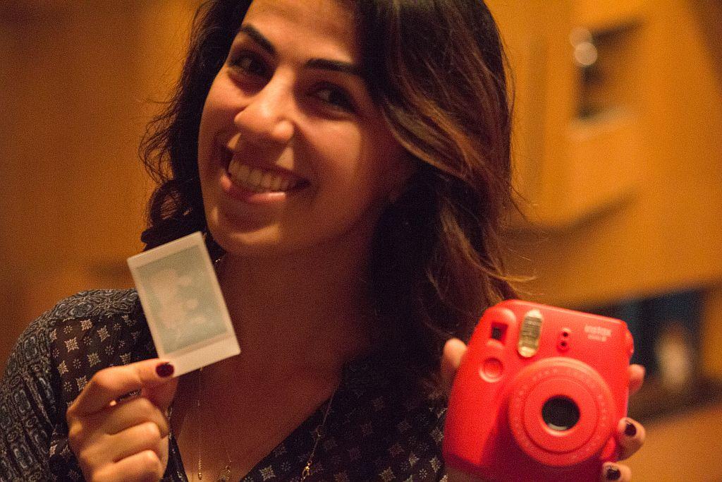 Girl with a Polaroid camera