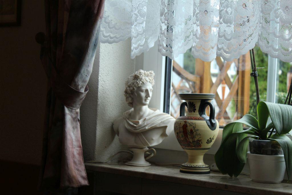 Greek sculpture head and a vase