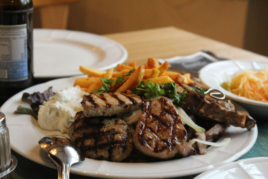 Grilled meat, French Fries and Tzaziki sauce