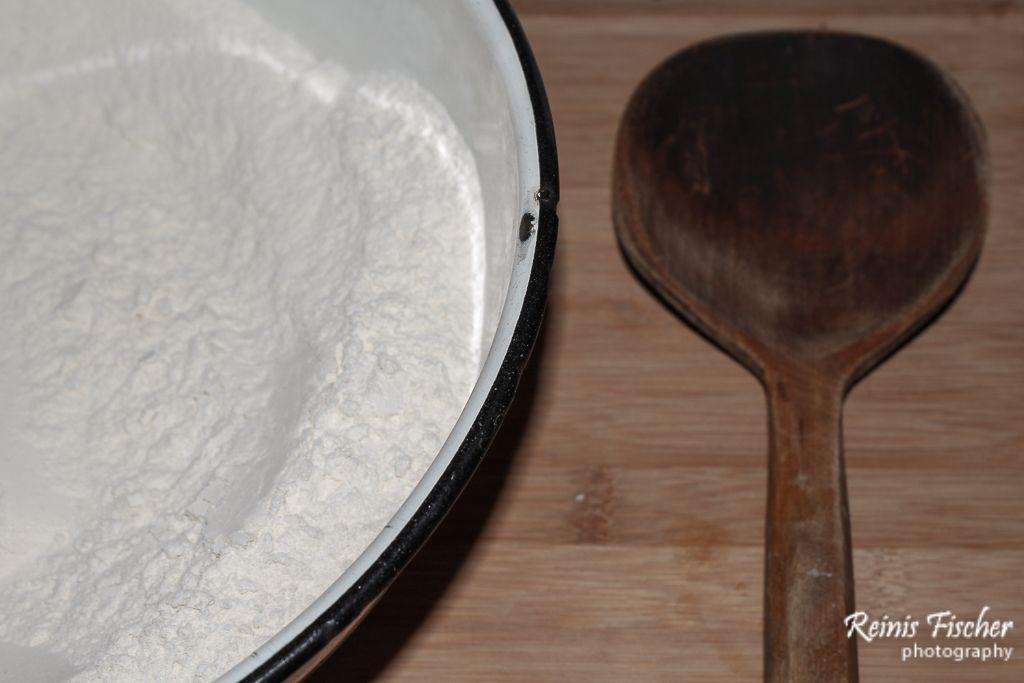 Put flour to the bowl