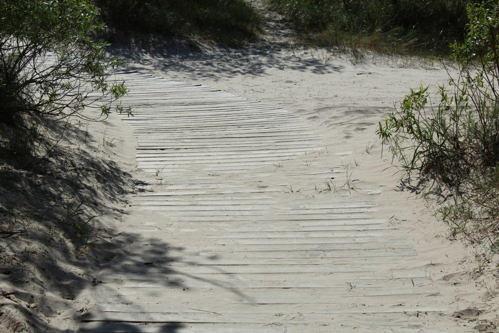 Wooden boardwalk heading to sea in Liepaja