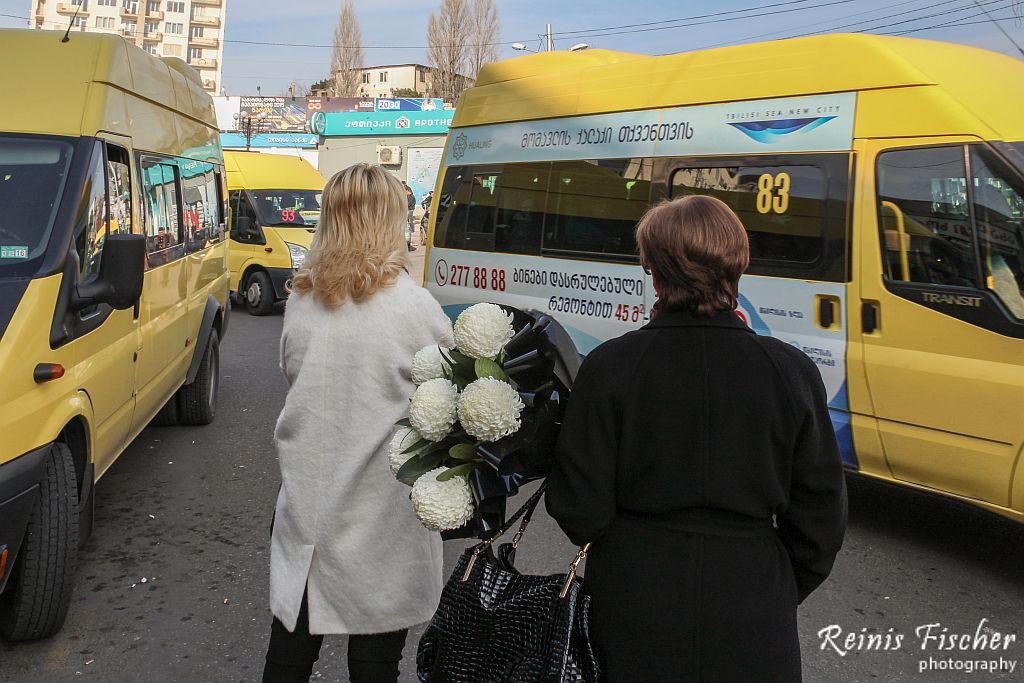 Women with flowers waiting for marshrutka