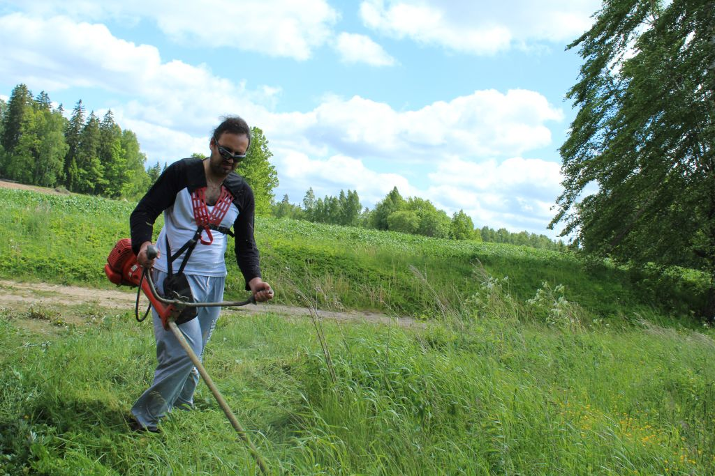 Author of this blog fighting grass with a trimmer