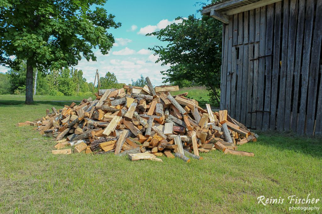 Firewood waiting to be stacked in barn