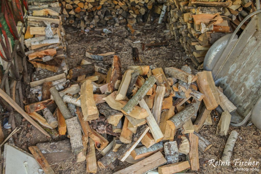 Stacking firewood in barn