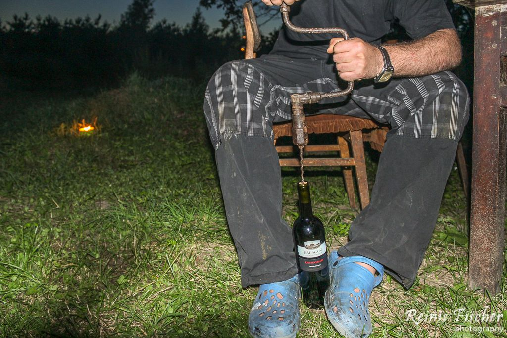 Opening bottle of wine with hand drill