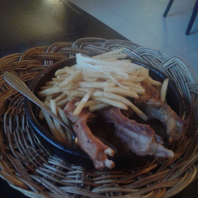 Grilled pork ribs served with French Fries in a hot Adjika sauce