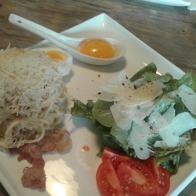 Italian lunch - salad Caesar with chicken and pasta carbonara